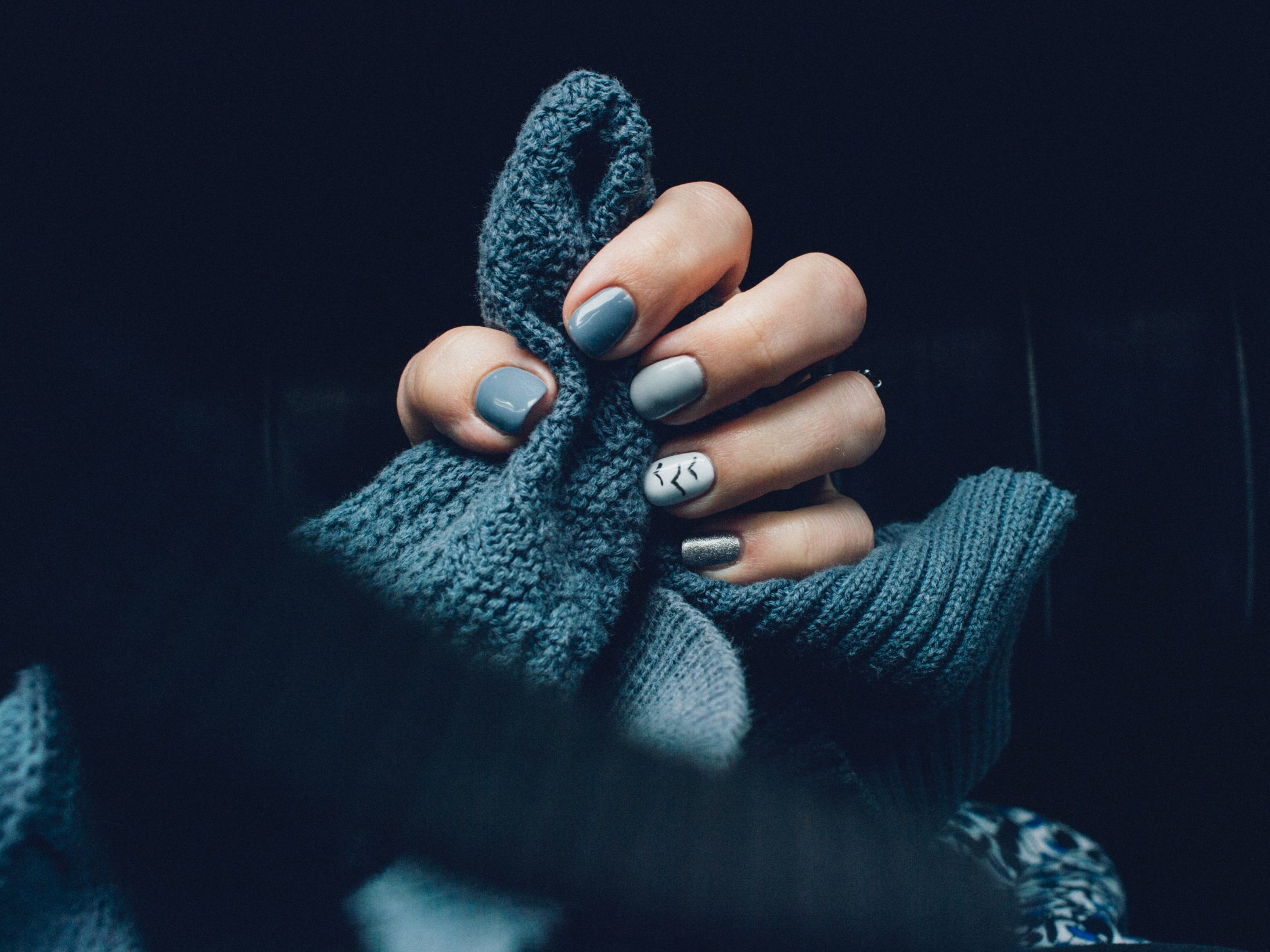 blue-knitted-clothing-and-nails-2567326